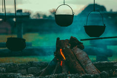 Black Cooking Pot Near Burning Woods Royalty Free Stock Images