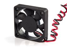 Black coolink fan. Black miniature cooling Fan with red and black wires, isolated on white, close-up view Royalty Free Stock Photo