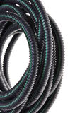 Black corrugated pipe with a green line Stock Image