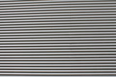 Black corrugated wall. Corrugated wall of industrial building Stock Photos