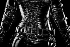 Black corset. Black latex corset, back wiev, high gloss stock photo