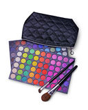 Black cosmetic bag and palettes of colored eyeshadow for makeup with brushes. Black cosmetic bag and palettes of colored eye shadow for make up with brushes stock photo