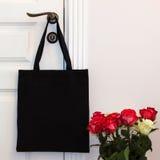 Black cotton eco tote bag, design mockup. Handmade shopping bags royalty free stock photo