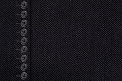 Black cotton texture with bottons. Closeup of grey canvas Royalty Free Stock Image
