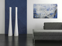 Black couch against blue and white wall Royalty Free Stock Photos