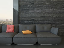 Black couch with colorful pillows against wooden wall Stock Photo
