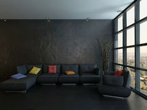 Black couch with colorful pillows against wooden wall Stock Photos