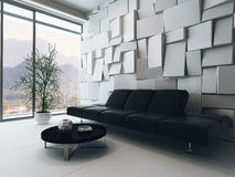 Black couch in front of white ornamental wall Royalty Free Stock Photography