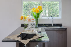 Black counter in pantry with vase of plant and modern sink Stock Photo