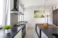 Black countertop in scandi kitchen. Black countertop in scandi minimalist kitchen interior arrangement stock photos
