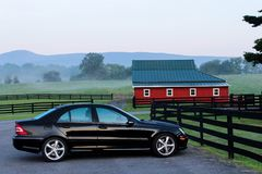 Black Coupe Near Black Wooden Fence during Daytime Royalty Free Stock Image