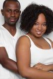 Black Couple. Smiling happy black couple hugging stock photography