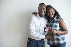 Black couple with a baby ultrasound photo Stock Images