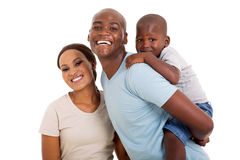 Black couple child. Cheerful young black couple with their child isolated on white stock photo