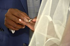Black couple exchanging wedding rings Royalty Free Stock Images
