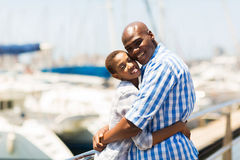 Black couple harbor. Cute young black couple hugging at the harbor royalty free stock photo