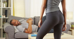 Black couple having a conversation in the living room Stock Photo