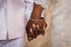 Black couple holding hands during marriage