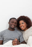 Black couple in love in the bed Stock Photos
