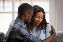 Black couple in love after quarrelling at home stock image