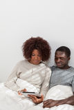 Black couple in love using the computer Royalty Free Stock Photo