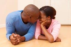 Black couple lying floor Royalty Free Stock Photos