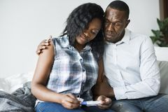 Black couple with a negative pregnancy test result stock photography