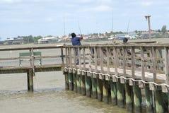 Black Couple Pier Fishing Gulf Coast stock photography