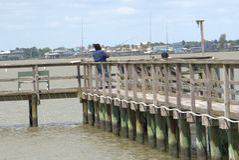 Black Couple Pier Fishing Gulf Coast in San Leon, TX stock photo