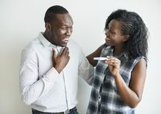 Black couple with a positive pregnancy test result stock photo