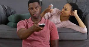 Black couple relaxing at home with their gadgets Royalty Free Stock Photo