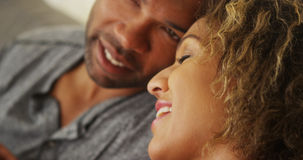 Black couple resting their heads together Stock Images