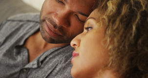 Black couple resting their heads together Stock Image