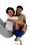 Black couple sitting on floor. Stock Photography