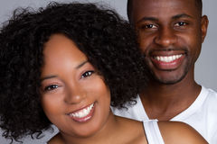 Black Couple Smiling. Happy young black couple smiling royalty free stock image