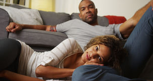 Black couple smiling and looking at camera royalty free stock photography