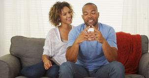 Black couple texting on smartphone royalty free stock photos