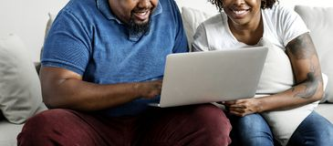 Black couple using digital device Royalty Free Stock Photography