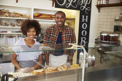 Black couple waiting behind the counter at a sandwich bar Stock Image