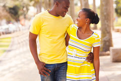 Black couple walking street Stock Photo