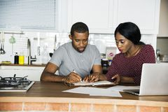 Black couple working in the kitchen royalty free stock photo