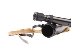 Black cover and spyglass lying. Royalty Free Stock Images