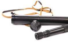 Black cover and spyglass lying. Stock Photography
