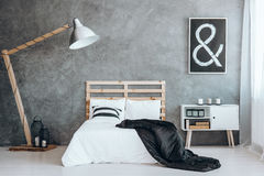 Black coverlet on king-size bed Stock Image