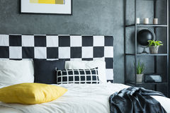 Black coverlet on king-size bed Royalty Free Stock Photos