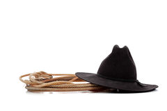 Black cowboy hat and lasso on white Stock Photography