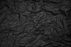 Black crampled paper. Surface for background royalty free stock photos