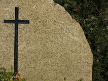 Black cross on granite background tombstone Royalty Free Stock Image
