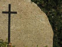 Black cross on granite background tombstone Royalty Free Stock Image