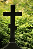 Black cross gravestone Stock Image